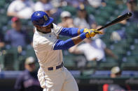 Seattle Mariners' Kyle Lewis singles against the Cleveland Indians in the third inning of a baseball game Sunday, May 16, 2021, in Seattle. (AP Photo/Elaine Thompson)