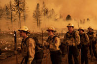 Firefighters from the California Department of Forestry and Fire Protection's Placerville station battle the Sugar Fire, part of the Beckwourth Complex Fire, in Doyle, Calif., Friday, July 9, 2021. (AP Photo/Noah Berger)