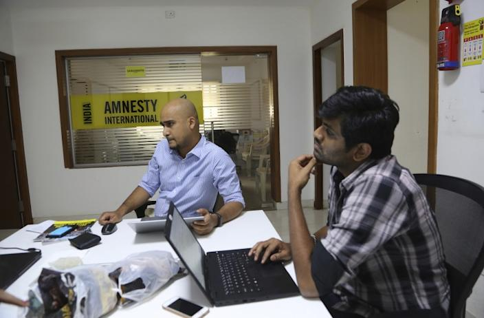 "Amnesty International India employees at their headquarters in Bangalore in February 2019. <span class=""copyright"">(Aijaz Rahi / Associated Press)</span>"