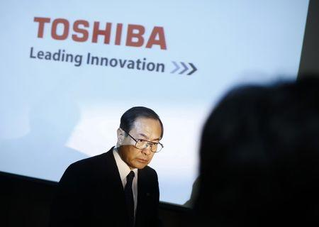 Toshiba Corp President and CEO Masashi Muromachi leaves a news conference at the company headquarters in Tokyo