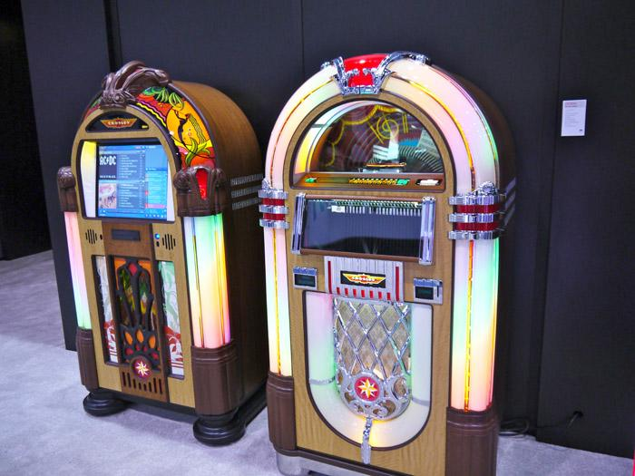 Here you have the classic beauty of mid-century jukebox machines but now with the ability to dock with an iPod, play CDs and AM/FM radio. From Crosley, and running about $9,000 for the one on the right. (Scott Ard/Yahoo! News)