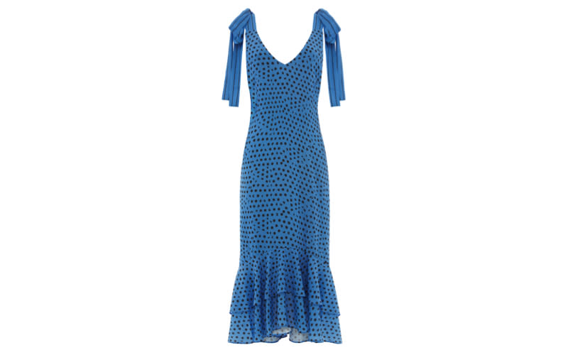 """Whistles is our first pit-stop when shopping for all things occasionwear and we're still loving polka dots this season - an investment piece you can even take on holiday. <a href=""""https://www.whistles.com/women/new-in/dresses/lunar-spot-tie-shoulder-dress-29592.html?cgid=Dresses_New_WW&dwvar_lunar-spot-tie-shoulder-dress-29592_color=Blue%2FMulti#start=0"""" rel=""""nofollow noopener"""" target=""""_blank"""" data-ylk=""""slk:Shop now"""" class=""""link rapid-noclick-resp""""><em>Shop now</em></a>."""