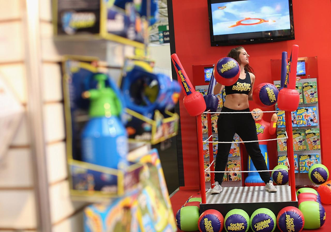 LONDON, ENGLAND - JANUARY 22:  A woman works out on a trade stand during the 2013 London Toy Fair at Olympia Exhibition Centre on January 22, 2013 in London, England. The annual fair which is organised by the British Toy and Hobby Association, brings together toy manufacturers and retailers from around the world.  (Photo by Dan Kitwood/Getty Images)