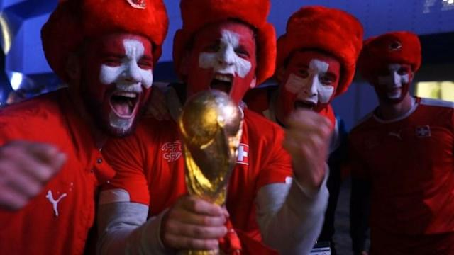Switzerland fans celebrate after a last-minute Xherdan Shaqiri breakaway goal hands their team victory coming from behind to defeat Serbia 2-1 in Kaliningrad.