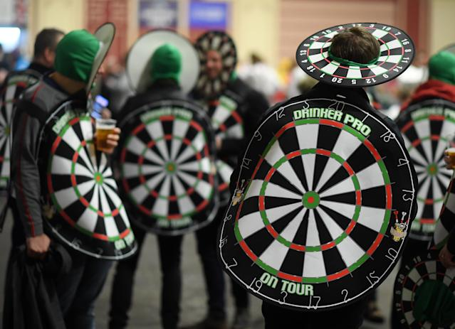 Fans appear at the darts dressed as a dart board. (Photo by Alex Davidson/Getty Images)
