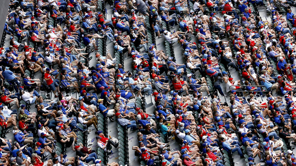 Fans, pictured here watching the Texas Rangers and Toronto Blue Jays.