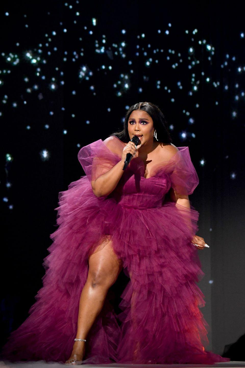 <p>Looking like a goddess at her AMA performance in a gown by Dauxilly. </p>