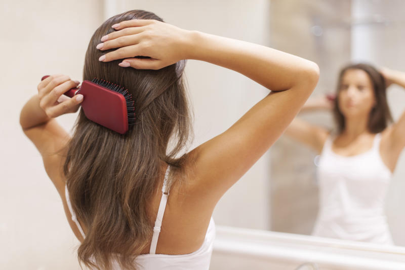 If you're digging hair out of your brush by the fistful, you're losing more hair than you're regrowing. (Photo: Getty)