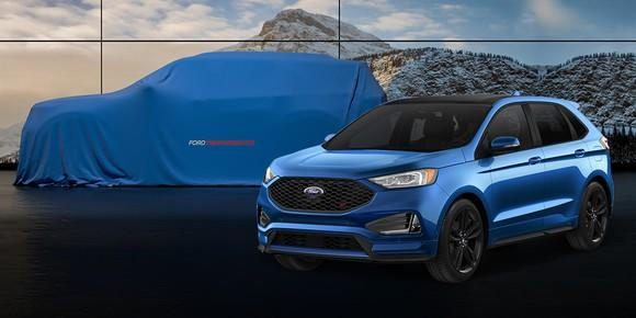 A blue 2019 Edge ST is shown in front of a second, larger SUV that is hidden by a blue cover