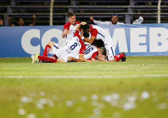 Soccer Football - Uruguay's Defensor Sporting v Paraguay's Cerro Porteno - Copa Libertadores - Luis Franzini Stadium, Montevideo, Uruguay - May 15, 2018 - Cerro Porteno's Diego Churin (obscured) is congratulated by team mates after scoring. REUTERS/Andres Stapff
