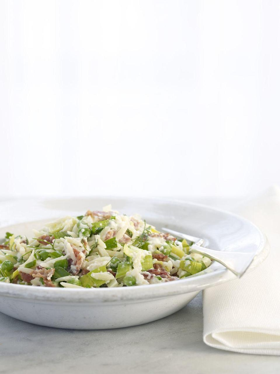 """<p>Make this adaptable Italian dish using pasta, bacon, and herbs of your choice. Some fresh summer herbs to consider: chervil, chives, and parsley.</p><p><strong><a href=""""https://www.countryliving.com/food-drinks/recipes/a2282/ricotta-orzo-clv/"""" rel=""""nofollow noopener"""" target=""""_blank"""" data-ylk=""""slk:Get the recipe."""" class=""""link rapid-noclick-resp"""">Get the recipe.</a></strong></p>"""