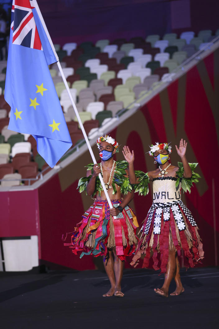 <p>TOKYO, JAPAN - JULY 23: Flag bearers Matie Stanley and Karalo Hepoiteloto Maibuca of Team Tuvalu during the Opening Ceremony of the Tokyo 2020 Olympic Games at Olympic Stadium on July 23, 2021 in Tokyo, Japan. (Photo by Jamie Squire/Getty Images)</p>