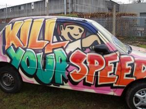 Car fully covered with anti-speeding slogan
