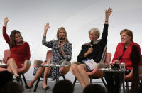 FILE - In this Tuesday, April 25, 2017 file photo, Canada's Foreign Minister Chrystia Freeland, Ivanka Trump, daughter and adviser of U.S. President Donald Trump and International Monetary Fund Managing Director Christine Lagarde, from left, jokingly raise their hands to support that they consider German Chancellor Angela Merkel, right, being a feminist during a panel at the W20 Summit in Berlin, Germany. Angela Merkel, Germany's first female chancellor, has been praised by many for her pragmatic leadership in a turbulent world and celebrated by some as a feminist icon. But a look at her track record in fighting gender inequality in 16 years running Germany reveals missed opportunities in promoting women's issues. (AP Photo/Markus Schreiber, File)
