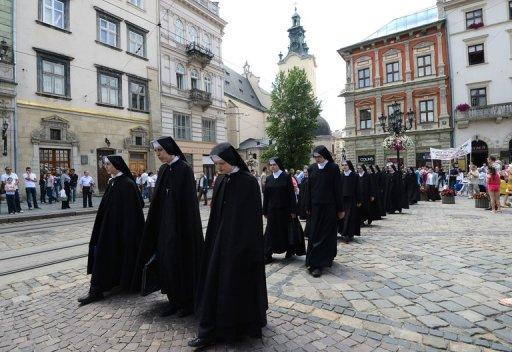 Nuns of the Ukrainian Orthodox Greek Catholic Church (UOGCC) stage a protest in Lviv