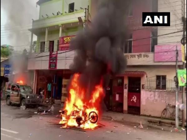Visuals of a vehicle on fire in Agartala on Wednesday. (Photo/ANI)