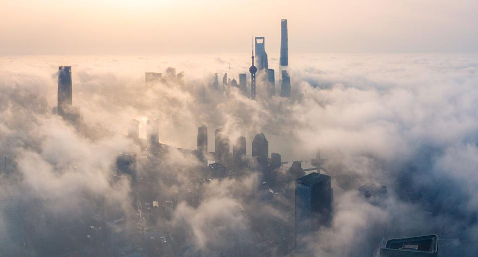Photo of fog blanketing a city skyline. Changes in air movements can cause severe turbulence on a flight.