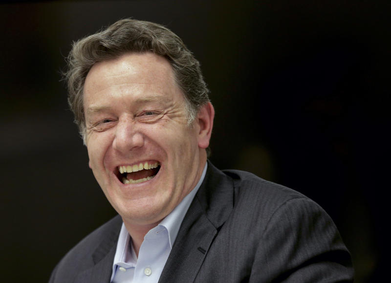 In this Thursday, May 1, 2014 photo, Domino's Pizza CEO Patrick Doyle laughs during an interview in New York. After having been plagued with a reputation for tasting generic and manufactured, the Ann Arbor, Mich.-based chain has been enjoying strong sales and growth overseas boasting nearly 6,000 international locations. (AP Photo/Julie Jacobson)