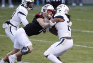 North Carolina State linebacker Payton Wilson (11) tackles Georgia Tech running back Jordan Mason for a loss during the first half of an NCAA college football game in Raleigh, N.C., Saturday, Dec. 5, 2020. (Ethan Hyman/The News & Observer via AP)