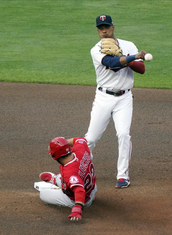 Minnesota Twins second baseman Jorge Polanco throws to complete the double play after the force at second on Los Angeles Angels' David Fletcher djring the first inning of a baseball game Thursday, July 22, 2021, in Minneapolis. Justin Upton hit into the double play. (AP Photo/Jim Mone)