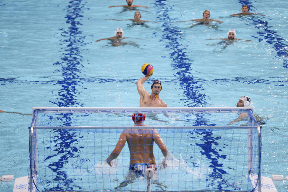 <p>Dusan Matkovic of Team Montenegro scores off a penalty throw against Branislav Mitrovic of Team Serbia during the Men's Preliminary Round Group B match between Serbia and Montenegro on day ten of the Tokyo 2020 Olympic Games at Tatsumi Water Polo Centre on August 02, 2021 in Tokyo, Japan. (Photo by Dan Mullan/Getty Images)</p>