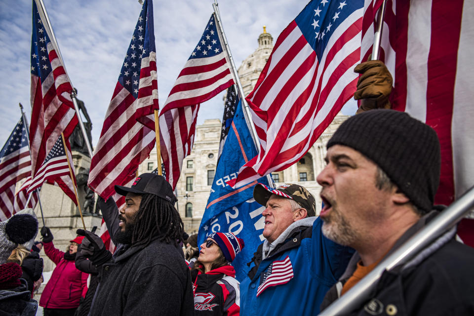 Protesters attend a rally in support of President Donald Trump on the steps of the Minnesota State Capitol on Wednesday, Jan. 6, 2021 in St. Paul, Minn. (Richard Tsong-Taatarii/Star Tribune via AP)