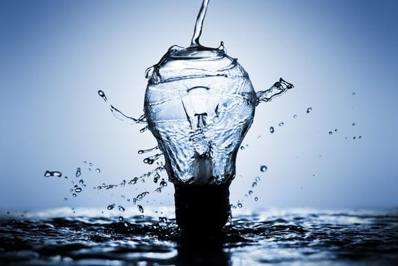 Water pouring over a light bulb