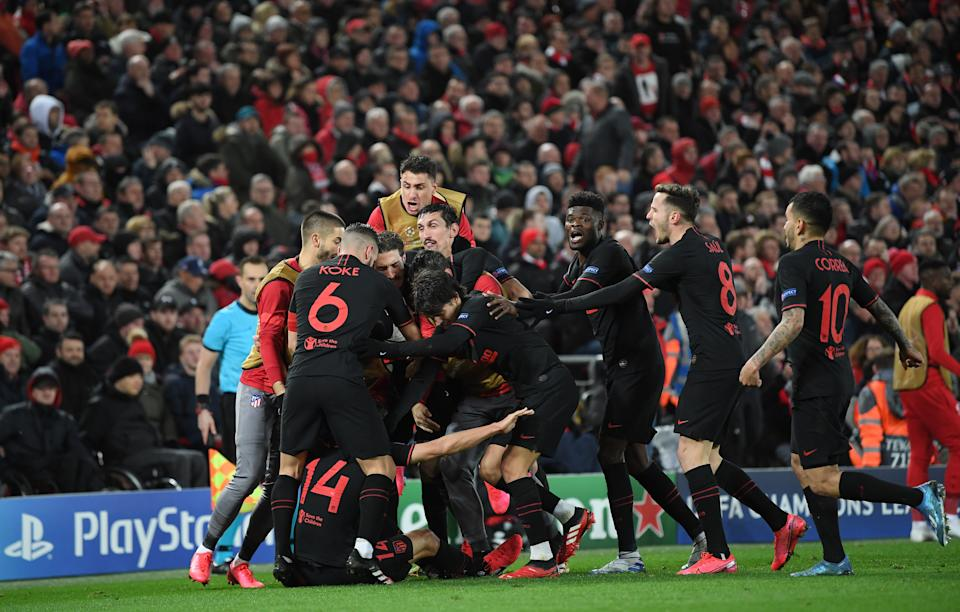Atletico Madrid players celebrate the second Marcos Llorente goal at Anfield in their stunning upset of Liverpool. (Photo by Michael Regan - UEFA/UEFA via Getty Images)