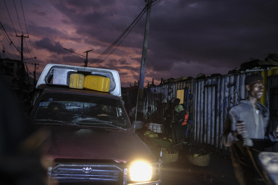 A man drives his car through the Petion-Ville market in Port-au-Prince, Haiti, late Wednesday, July 14, 2021. President Jovenel Moise was assassinated in his home on July 7. (AP Photo/Matias Delacroix)