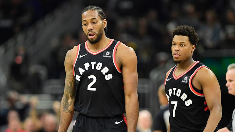 Toronto Raptors forward Kawhi Leonard (2) and Toronto Raptors guard Kyle Lowry (7) react during a break in play first half Game 2 of the NBA basketball Eastern Conference finals against the Milwaukee Bucks in Milwaukee on Friday, May 17, 2019. THE CANADIAN PRESS/Frank Gunn