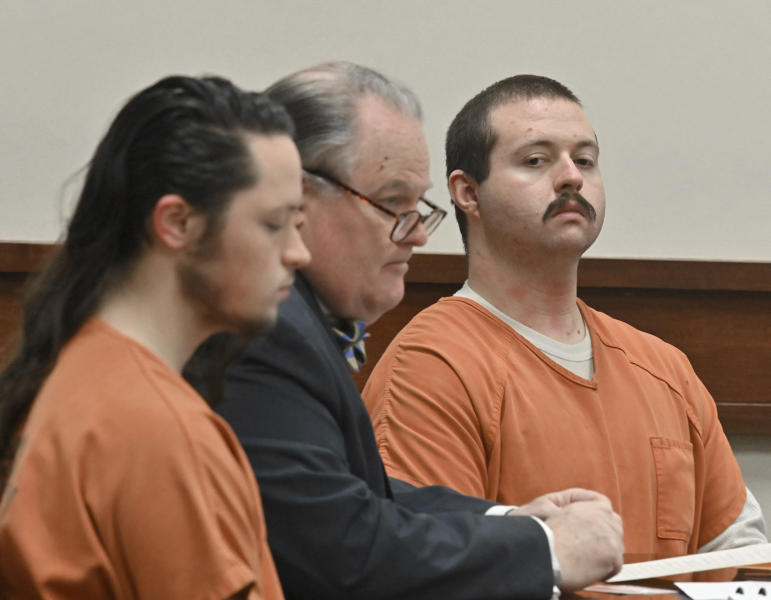 Jacob Kaderli, left, and Michael Helterbrand, right, sit with Helterbrand's attorney Radford Bunker as Kaderli's attorney John Lovell (not pictured) speaks before Floyd County Superior Court Judge Jack Niedrach (not pictured) at Floyd County Superior Court in Rome, Ga., on Friday, Feb. 14, 2020. Bond was denied Friday for the two Georgia men authorities say are linked to a violent white supremacist group known as The Base. The two men are charged, along with 22-year-old Luke Lane of Silver Creek, of conspiring to kill members of a militant anti-fascist group and participating in a criminal gang. (Hyosub Shin/Atlanta Journal-Constitution via AP)/