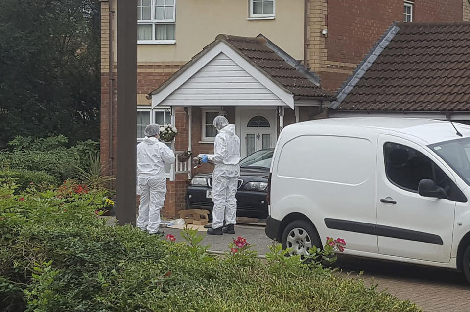 Police attend the scene where two teenage boys were stabbed to death Saturday night following an altercation, in Milton Keynes, southern England, Sunday Oct. 20, 2019.  One of the the 17-year-old victims, who have not been named by police, died at the scene, while the other died later in hospital Sunday morning. (Gus Carter/PA via AP)