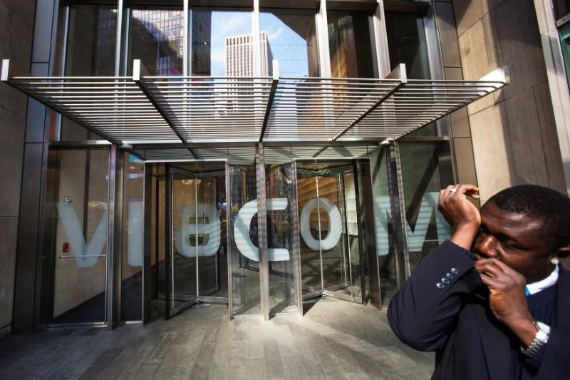 A security guard speaks into a microphone in his sleeve outside the Viacom Inc. headquarters in New York