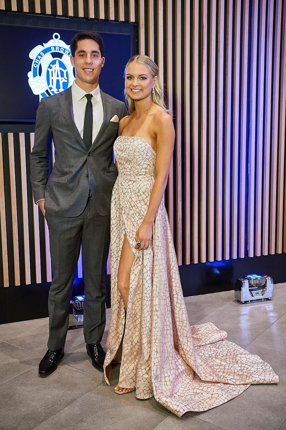 Adam Cerra and partner Claudia Piva pose for a photo during the 2020 Brownlow Medal Count at Optus Stadium on October 18, 2020 in Perth, Australia.