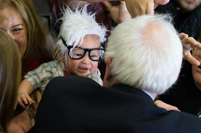 <p>FEB. 14, 2016 — Democratic presidential candidate Sen. Bernie Sanders, I-Vt., right, meets 3-month-old Oliver Jack Carter Lomas-Davis, of Venice, Calif., who was dressed as Sanders during a rally at Bonanza High School in Las Vegas. Baby Bernie, the cheerful toddler who won the affections of people of all political stripes after his mom posted photos of him greeting Democratic presidential candidate Bernie Sanders in a white-haired wig and over-sized glasses, has died at the age of 4 months. Lomas-Davis of Los Angeles died Feb. 25 of Sudden Infant Death Syndrome. (Evan Vucci/AP) </p>