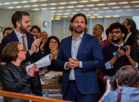 L-R; Michele McNally, assistant editor and director of photography of The New York Times; David Furst, international picture editor; photojournalist Daniel Berehulak, celebrate the announcement of the 2017 Pulitzer Prizes in The Times newsroom, in New York, U.S., April 10, 2017. Hiroko Masuike/Courtesy The New York Times/Handout via REUTERS