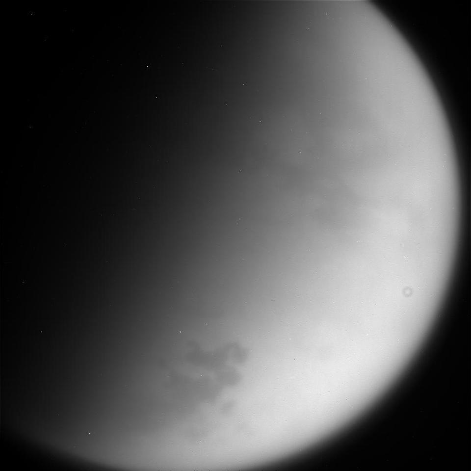 This Wednesday, Sept. 13, 2017 image taken using the CL1 and RED filters and made available Thursday by NASA shows Saturn's moon Titan, as seen from the Cassini spacecraft. NASA's Cassini spacecraft at Saturn is closing in on its fiery finish, following a remarkable journey of 20 years. Cassini is on course to plunge through Saturn's atmosphere and vaporize like a meteor Friday morning. (NASA/JPL-Caltech/Space Science Institute via AP)