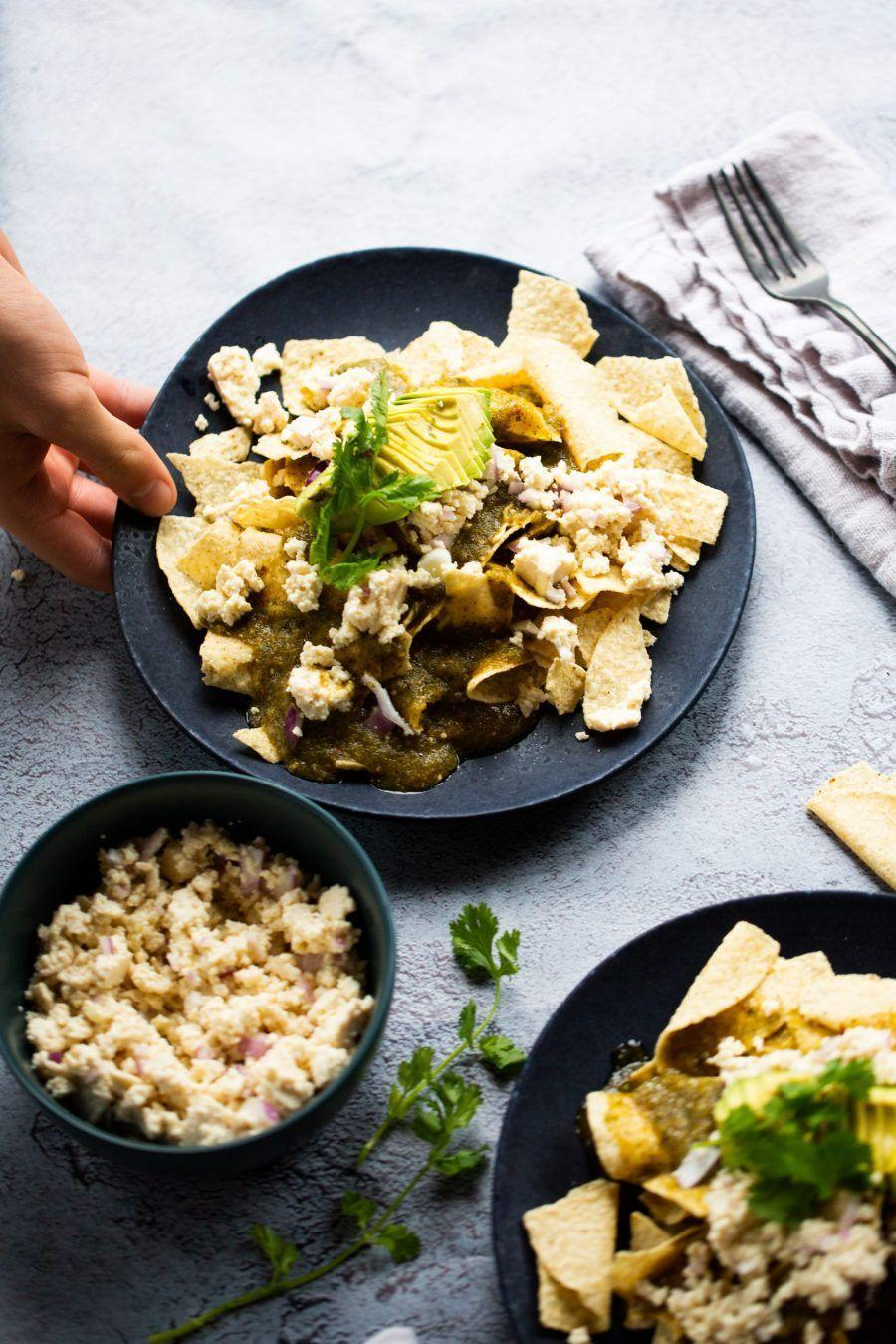 """<p>This comfort food staple made of crunchy corn tortillas cut into triangles comes in too many savory topping combinations to count. This version uses smoky chile chipotles in adobo sauce, roasted garlic, fresh cilantro, and tomatillos for an ideal vegan breakfast (or late-night snack).</p><p><a class=""""link rapid-noclick-resp"""" href=""""https://www.brownsugarandvanilla.com/chilaquiles-with-chipotle-tomatillo-sauce/"""" rel=""""nofollow noopener"""" target=""""_blank"""" data-ylk=""""slk:GET THE RECIPE"""">GET THE RECIPE</a></p><p><em>Per serving: 987 calories, 37 g fat (6 g saturated), 1,332 mg sodium, 19 g carbs, 19 g sugar, 8 g fiber, 113 g protein</em></p>"""