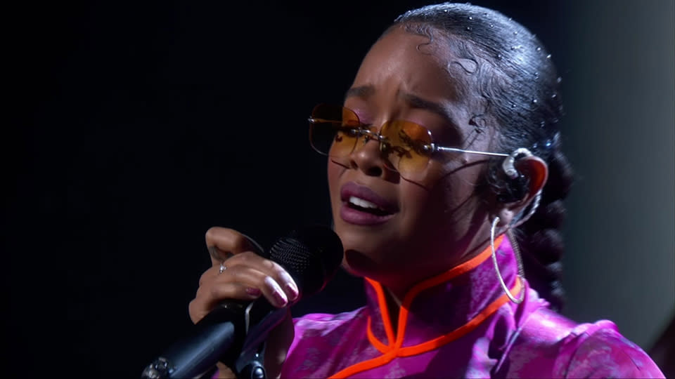 Grammy-winning singer H.E.R. took to the stage for the 2020 Emmys in recognition of the many celebrities who died this year. (Photo: ABC)