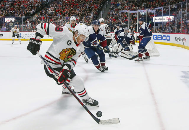 Chicago Blackhawks right wing Patrick Kane (88) controls the puck against the Colorado Avalanche during the first period of an NHL hockey game, Saturday, March 23, 2019 in Denver. (AP Photo/Jack Dempsey)