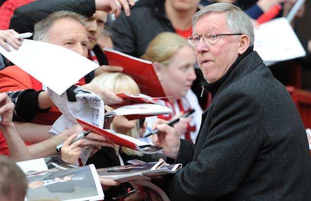 Manchester United manager Sir Alex ferguson signs autographs before taking his seat for his last Barclays Premier League match at Old Trafford, Manchester.