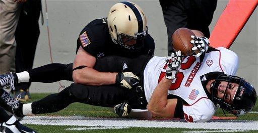 Northern Illinois' Jamison Wells is taken out-of-bounds after a pass reception by Army's Alex Meier late in the second half in an NCAA college football game in West Point, N.Y., on Saturday, Sept. 15, 2012. (AP Photo/Craig Ruttle)