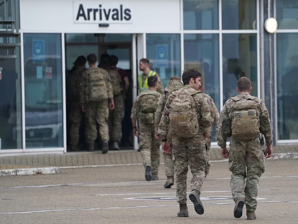 Members of the British armed forces 16 Air Assault Brigade walk to the air terminal after departing a flight from Afghanistan at RAF Brize Norton, Oxfordshire. The final UK troops and diplomatic staff were airlifted from Kabul on Saturday, drawing to a close Britain's 20-year engagement in Afghanistan and a two-week operation to rescue UK nationals and Afghan allies. Picture date: Sunday August 29, 2021.