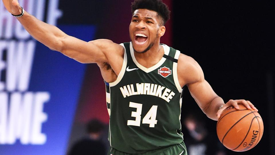 Giannis Antetokounmpo is pictured handling the ball in an NBA game against the Washington Wizards.