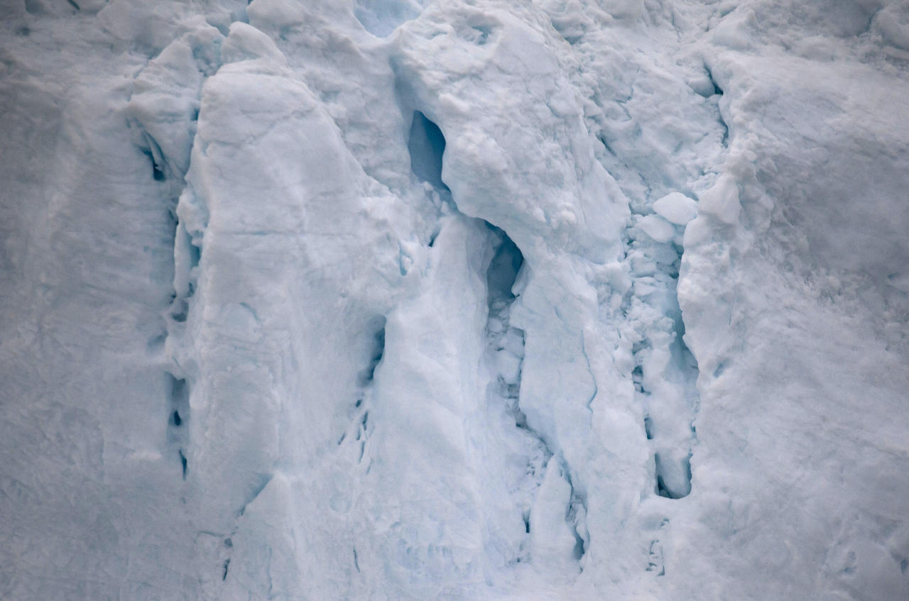 This July 18, 2011 photo shows the contours of an iceberg shed from the Greenland ice sheet, near Ilulissat, Greenland. (AP Photo/Brennan Linsley)