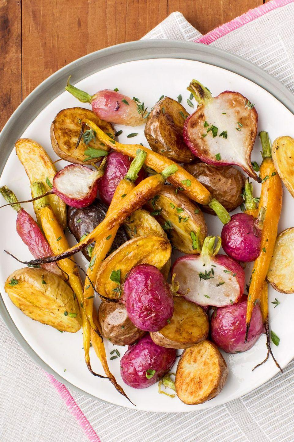 """<p>Rich in color and flavor, these root veggies, dressed in thyme and parsley, are the perfect spring side dish.</p><p><a href=""""https://www.goodhousekeeping.com/food-recipes/a43199/herb-roasted-root-vegetables-recipe/"""" rel=""""nofollow noopener"""" target=""""_blank"""" data-ylk=""""slk:Get the recipe for Herb-Roasted Root Vegetables »"""" class=""""link rapid-noclick-resp""""><em>Get the recipe for Herb-Roasted Root Vegetables »</em></a></p>"""