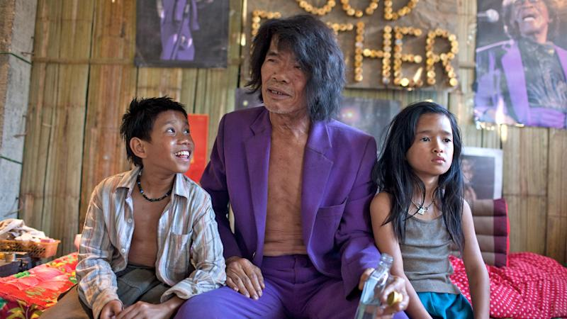 "This undated publicity image released by the TriBeca Film Festival shows Sitthiphon Disamoe as Ahlo, left, Thep Phongam as Purple, and  Loungnam Kaosainam as Kia in a scene from ""The Rocket,"" a film competing in the Tribeca Film Festival. The Laos adventure ""The Rocket"" and the Afghanistan War documentary ""The Kill Team"" have taken top honors at the Tribeca Film Festival on Thursday, April 25, 2013. (AP Photo/Tribeca Film Festival, Tom Greenwood)"