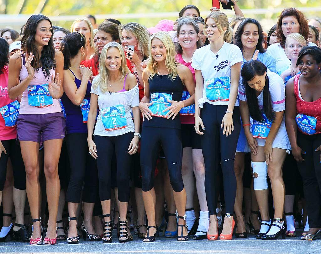 """Kristin Chenoweth, Kelly Ripa, and AnnaLynne McCord took part in the """"Live With Regis and Kelly"""" High Heel-a-thon in New York's Central Park on Wednesday. Participants in the 150-yard dash had to wear at least 3-inch heels, which, for Ripa, was """"like wearing flats because I usually wear 6-inch heels,"""" she cracked. Proceeds from the event went to the Heart Truth campaign, which raises awareness about heart disease and women's health. Jackson Lee/<a href=""""http://www.splashnewsonline.com"""" target=""""new"""">Splash News</a> - September 22, 2010"""