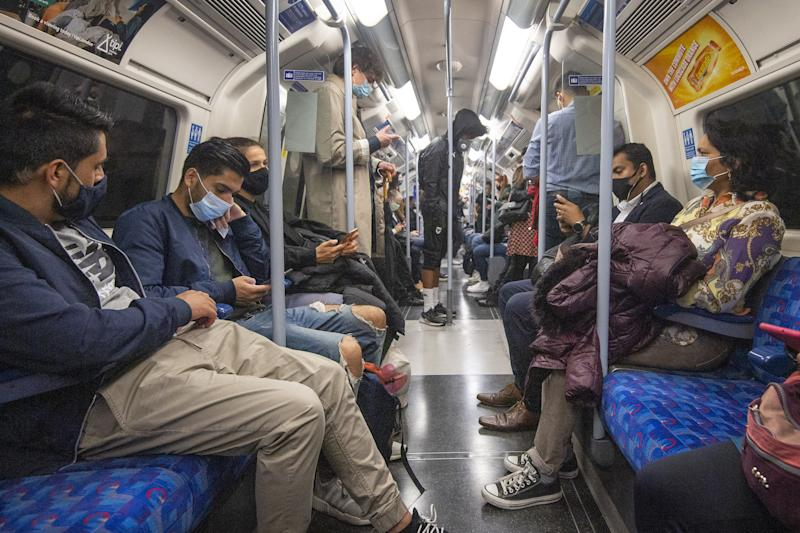 "Passengers wearing face masks on the Jubilee Line in London, as workers are being encouraged to return to their offices, with a Government PR blitz commencing this week reminding people about the efforts taken to make workplaces ""Covid-secure"". (Photo by Victoria Jones/PA Images via Getty Images)"