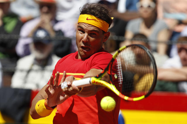 Spain's Rafael Nadal return the ball to Germany's Alexander Zverev during a World Group Quarter final Davis Cup tennis match between Spain and Germany at the bullring in Valencia, Spain, Sunday April 8, 2018. (AP Photo/Alberto Saiz)